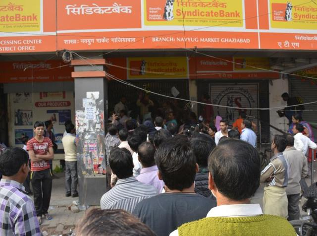 People standing outside a bank in Ghaziabad, November 19, 2016.  According to a report,  people who deposit their unaccounted old currency in someone else's bank account  will be prosecuted by the I-T department.