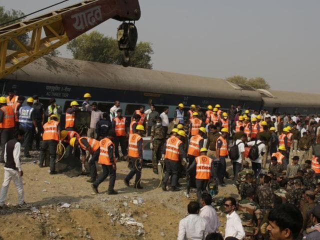 Rescuers work at the site of a train derailment accident in Kanpur Dehat.