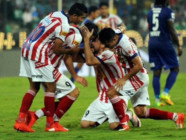 Atletico De Kolkata's Helder Manuel Postiga celebrates with teammates after scoring against Chennaiyin FC during the Indian Super League (ISL) football match at Jawaharlal Nehru Stadium in Chennai on Sunday.