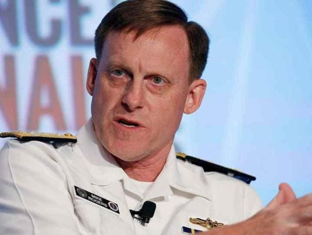 National Security Agency (NSA) Director Admiral Michael Rogers participates in a session at the third annual Intelligence and National Security Summit in Washington.