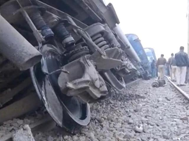 In this image made from video, people gather at the site of a train accident near Pukhrayan, about 270 kilometers  from Allahabad.