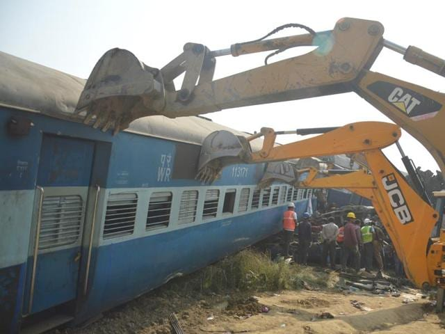 Kanpur, India - November 20: Rescue workers search for survivors at the site of a train derailment in Kanpur Dehat district.