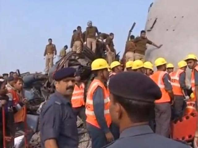 Rescuers and police gather at the site of a train derailment near Kanpur, Uttar Pradesh.