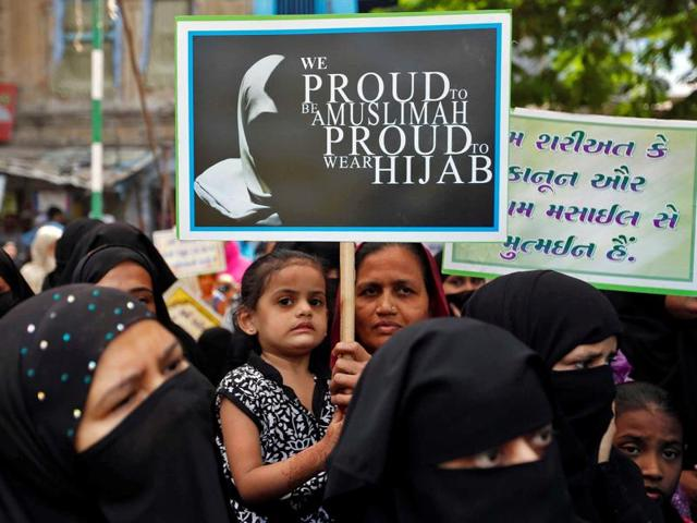 Muslim women show their support of the All India Muslim Personal Law Board (AIMPLB) during a signature campaign in Ahmedabad, on October 16, 2016.