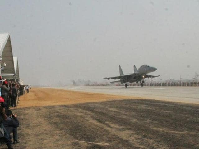 An IAF fighter jet touches down on a stretch of the Lucknow-Agra expressway in Unnao on Monday.