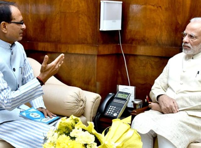 Shivraj Singh Chouhan with Narendra Modi in New Delhi.