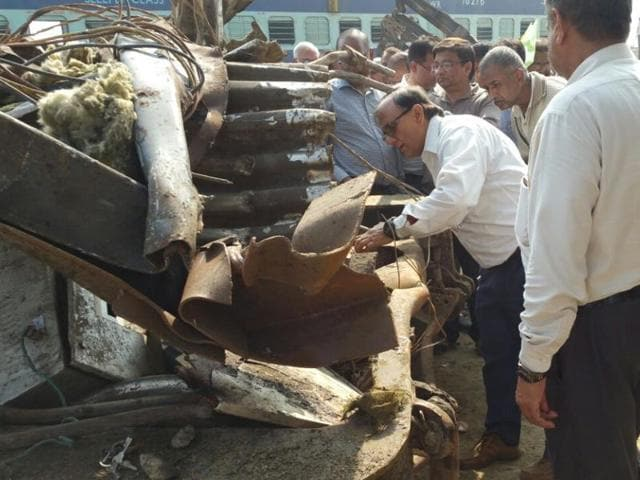Commissioner of railway safety (Eastern) PK Acharya inspects the wreckage of the Indore-Patna Express, which derailed near Kanpur, on Monday.