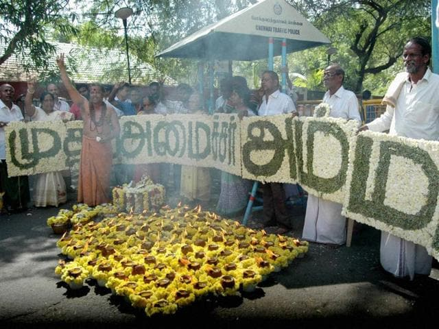 AIADMK members offer special prayers for the speedy recovery of party supremo and chief minister J Jayalalithaa, in front of Apollo Hospital in Chennai.