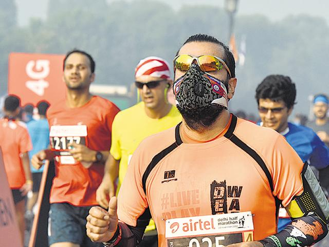 Many among the 12,000 participants at Sunday's half marathon were seen running wearing masks, at least for the first lap, to protect from the infamous Delhi air.