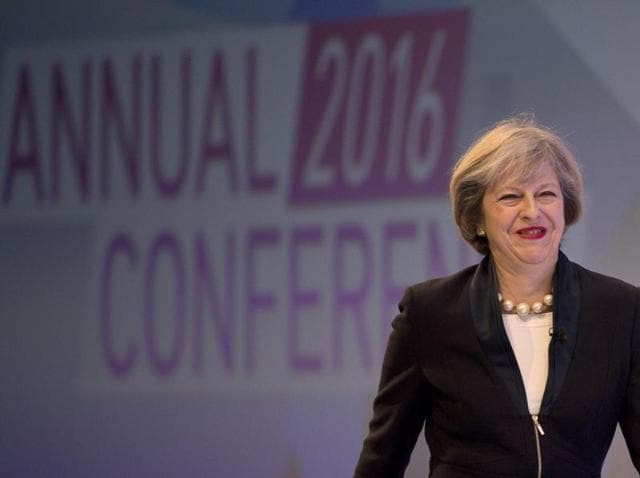 British Prime Minister Theresa May arrives to address delegates at the annual Confederation of British Industry (CBI) conference in central London on Monday.