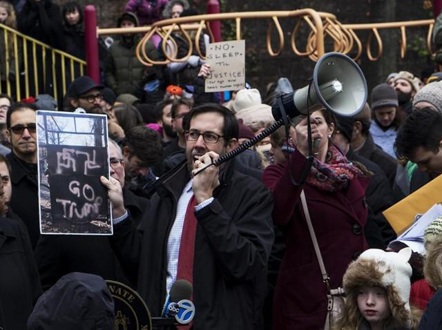 At least 300 people protested in New York on Sunday  after swastikas appeared in a Brooklyn park.
