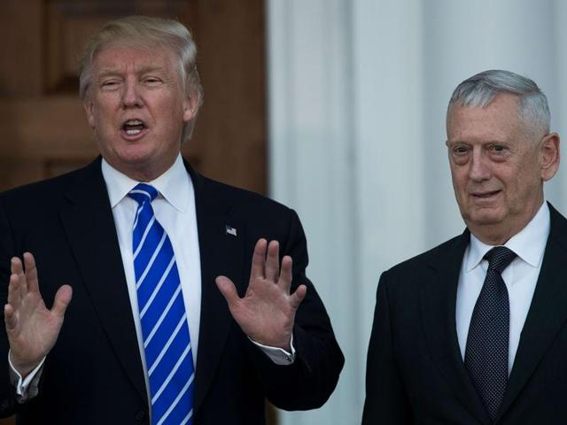 President-elect Donald Trump speaks to reporters as he stands alongside retired United States Marine Corps general James Mattis after their meeting at Trump International Golf Club in Bedminster Township, New Jersey.