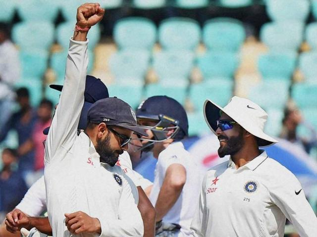 Captain Virat Kohli celebrates with Ravindra Jadeja and teammates after India beat England on the final day of the Vizag Test.