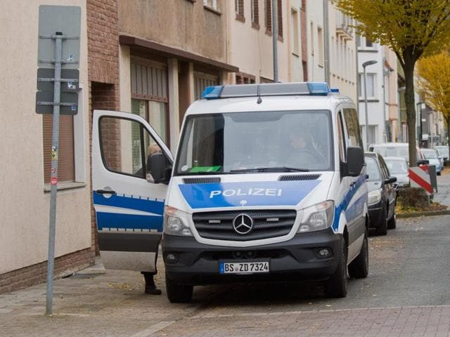 Policemen secure a street in Hameln, Germany, Monday Nov. 21, 2016. A woman was seriously injured when she was dragged Sunday through the streets of the northern German town behind a car with a cord tied around her neck.