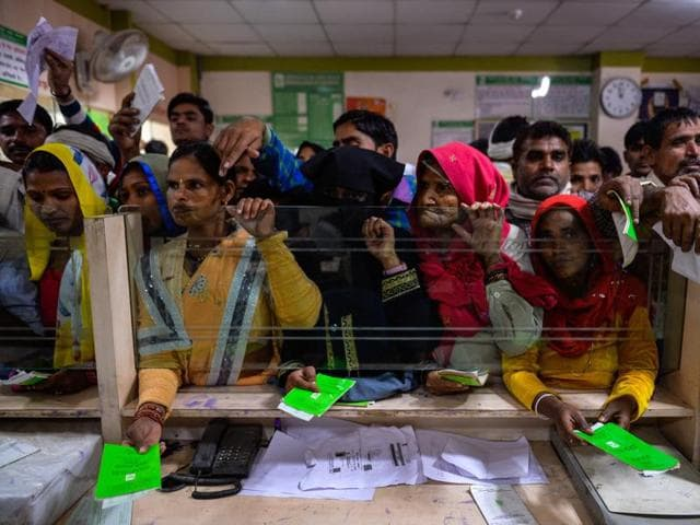 Villagers wait inside a bank to make the transactions in Basendua village in Bulandshahr, in Uttar Pradesh.