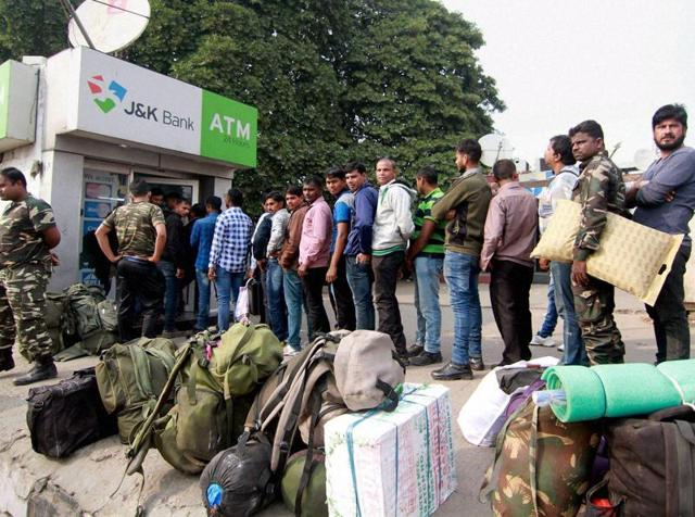 Gurugram : People stand in a long queue outside an ATM to withdraw money in Gurugram on Sunday.