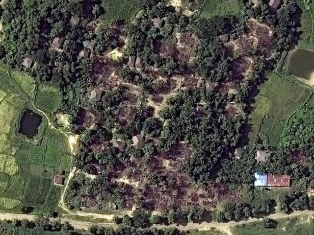 This satellite image taken by DigitalGlobe and distributed by Human Rights Watch shows the building destruction in the village of Wa Peik, Maungdaw District, Myanmar.