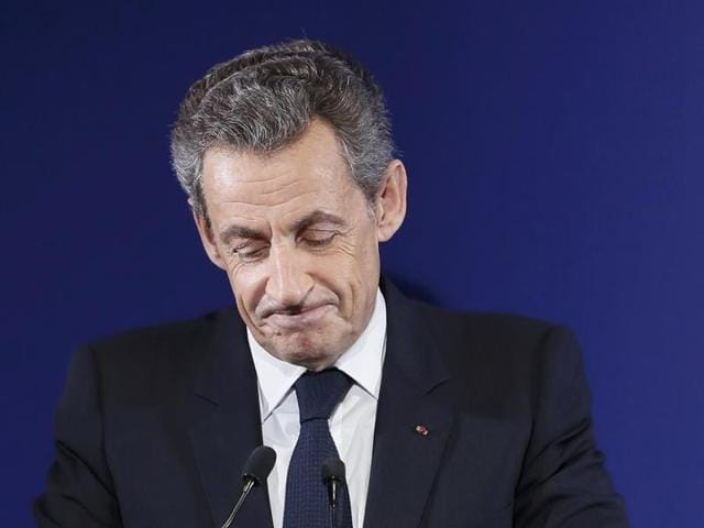 Nicolas Sarkozy, former French president and candidate for the French conservative presidential primary, reacts after the results in the first round of the French center-right presidential primary election at his headquarters in Paris.