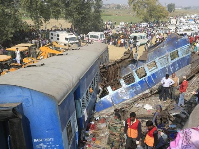 Rescue workers search for survivors at the site of a train derailment in Pukhrayan, south of Kanpur city.(HT Photo)