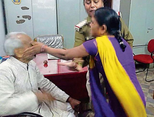 A photo still shows an alleged rape victim hitting Agrawal.