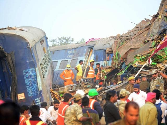 Rescue workers search for survivors in the wreckage of  Indore-Patna Express that derailed near Kanpur Dehat district.