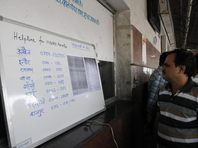 A railway official at a helpdesk at Bhopal railway station shows the list of passengers who boarded from there.