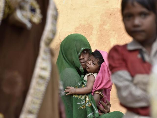 """Halku Adivasi's 15-month-old son Anil died of severe malnutrition last Tuesday, following which his second son was given BCG and DPT vaccines together. """"He hasn't stopped crying since he was vaccinated, what have you done to him?"""" his distraught wife Anjana asks the aganwadi worker in their home in Kalarna village in Sheopur district in Madhya Pradesh."""