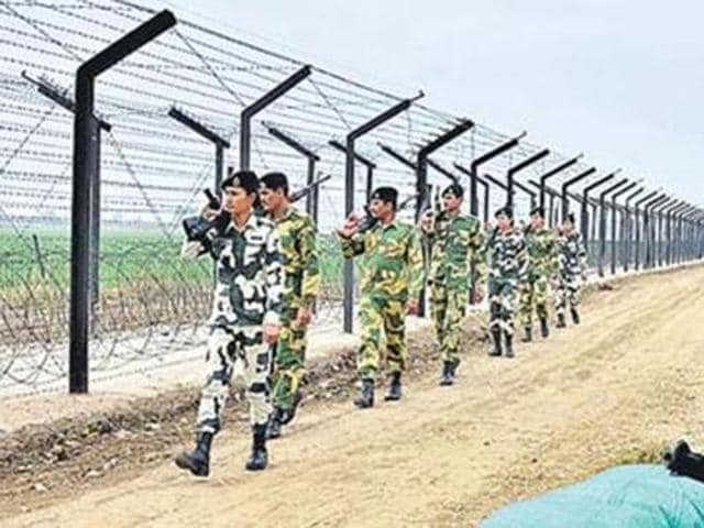 BSF jawans continue their vigil along the Indo-Pakistan International Border in Amritsar.  Pakistan summoned Indian envoy on Monday, Nov 21, 2016, to protest 'ceasefire violations' at the LoC.