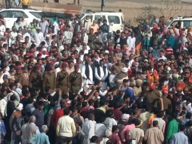 Protesting government's biased compensation policy villagers blocked NH-10 on Tuesday