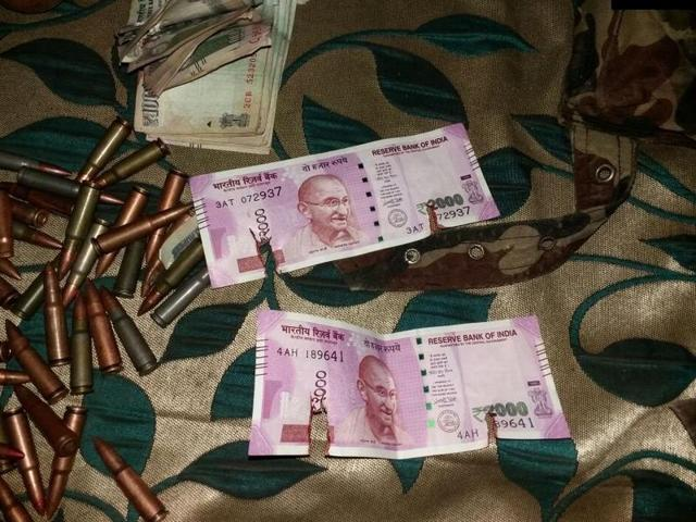 Two Rs 2,000 notes were found on the two militants who were shot dead on Tuesday in an encounter by security forces in Jammu and Kashmir's Bandipora district.