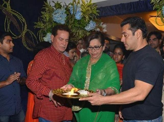 Screenwriter Salim Khan along with his son Salman Khan and wife Helen participates in a procession for the immersion of an idol of Lord Ganesh in a file photo from September 18, 2015. (IANS)
