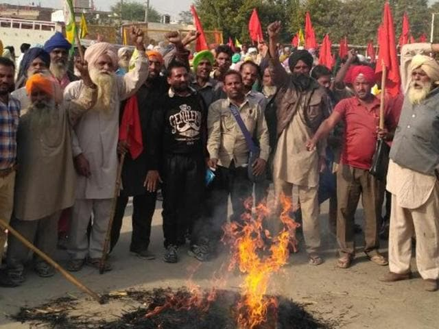 Upper caste farmers staged a protest outside sub-divisional magistrate office