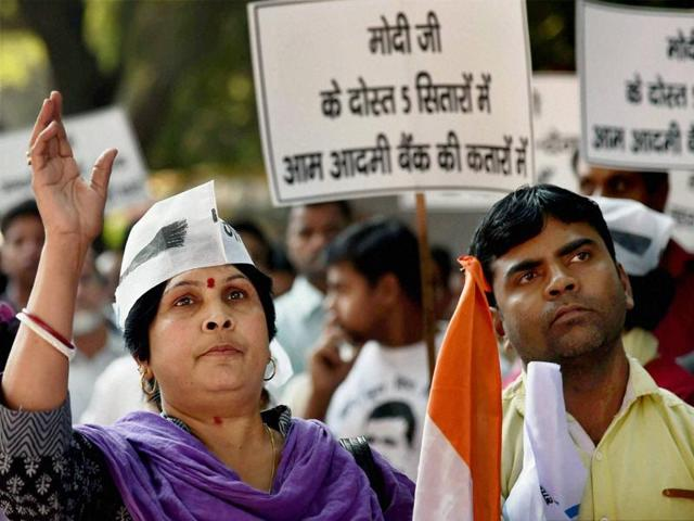 Volunteers of Delhi's ruling AAP march against the Centre's demonetisation move, in New Delhi on Tuesday.