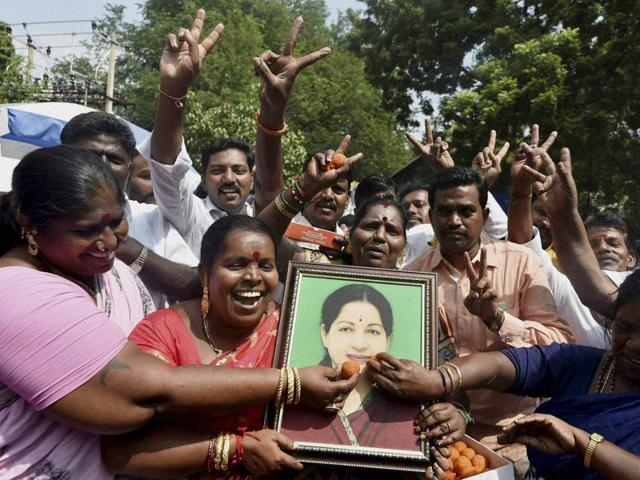 AIADMK cadres celebrating for their party's victory of three Assembly bypolls in front of Apollo Hospital where J Jayalalithaa is undergoing treatment in Chennai on Tuesday.