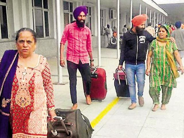 Members of the Sikh jatha coming back from Pakistan after observing the birth anniversary of Guru Nanak, at the Attari railway station in Amritsar on Monday.