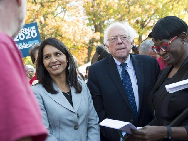 Tulsi Gabbard (left) with Bernie Sanders during a rally to stop the Trans-Pacific Partnership on November 17.