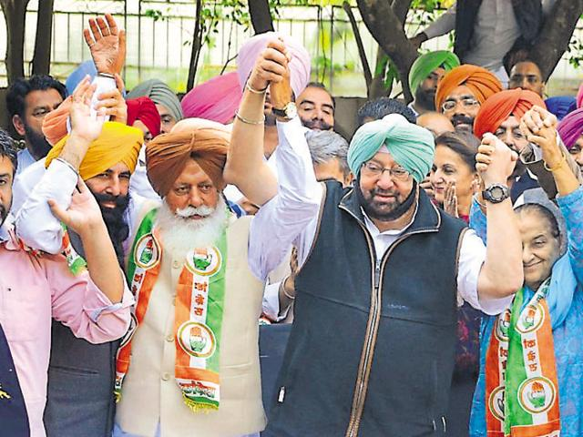Punjab Congress president Captain Amarinder Singh with newly inducted leaders in Chandigarh on Monday.