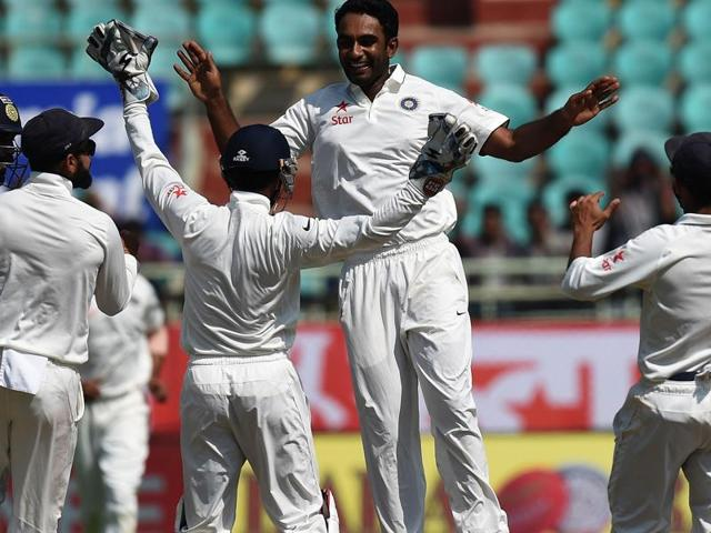 Jayant Yadav celebrates the wicket of England's Ben Stokes with Virat Kohli and teammates during the last day of the second Test cricket between India and England in Vishakhapatnam.