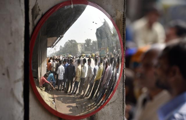People in a queue outside a bank in New Delhi.