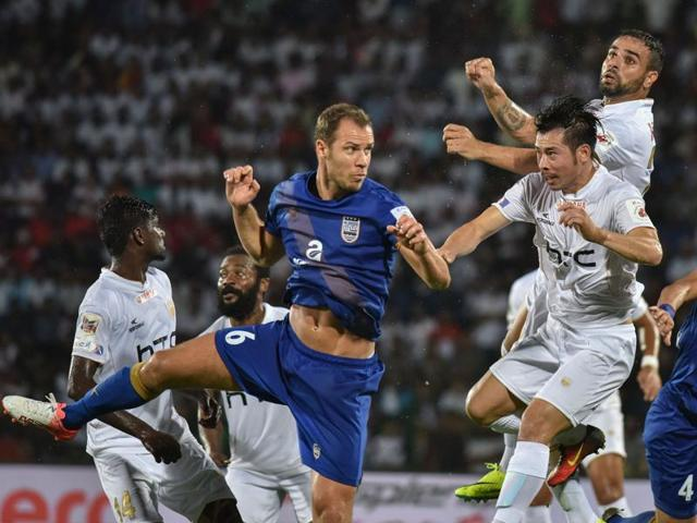 Action in an October 20 match between NorthEast United FC (in white) and Chennaiyin FC in Guwahati. The Guwahati-based team's hopes for a playoff have risen by the 1-0 win over FC Pune City.