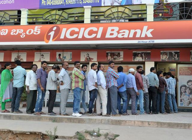People stand in long queue at Punjab National Bank to change or deposit the Demonetization of 500 and 1000 banknotes was a step taken by the Government of India  on November 21, 2016.