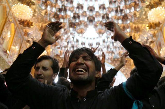 Shia Muslim pilgrims gather outside the Imam Hussein shrine on the last day of the Arbaeen religious festival on November 21, 2016, in the holy Iraqi city of Karbala, 50 miles (80 kilometres) south of Baghdad.