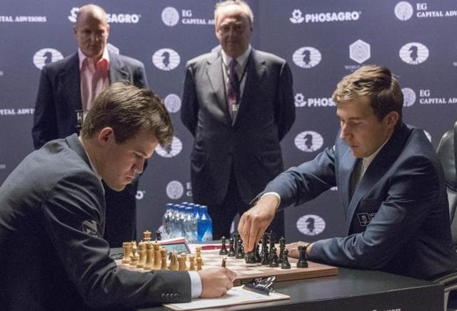 After the first seven games of their match ended in draws, Challenger Sergey Karjakin, right, of Russia beat chess world champion Magnus Carlsen, of Norway.