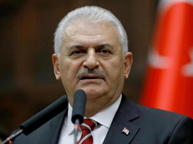 Turkey's Prime Minister Binali Yildirim addresses members of parliament from his ruling AK Party (AKP) during a meeting at the Turkish parliament in Ankara.