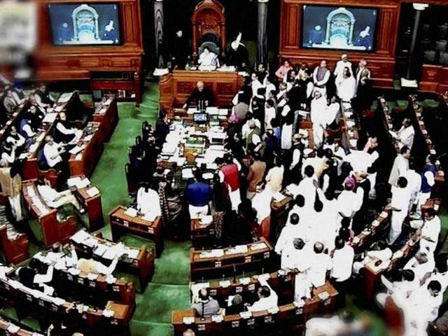 Opposition members protest in the well of Lok Sabha during the winter session of Parliament in New Delhi on November 18, 2016.