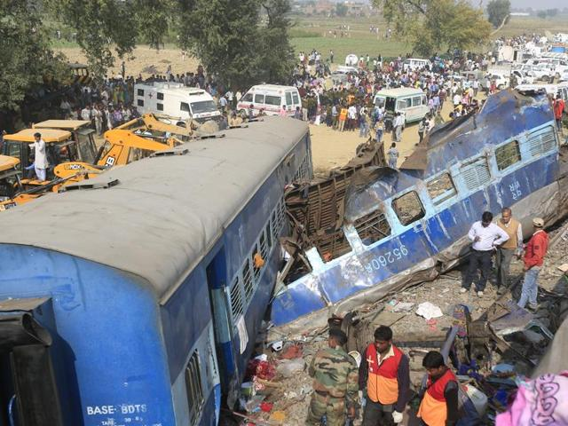 Rescue workers search for survivors at the site of a train derailment in Pukhrayan, south of Kanpur,  on November 20, 2016.