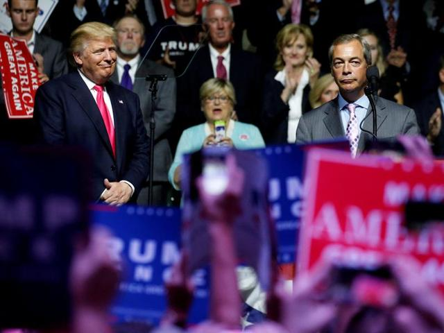 File photo of then Republican presidential candidate Donald Trump (right) welcoming pro-Brexit British politician Nigel Farage to speak at a campaign rally in Jackson in August 2016.