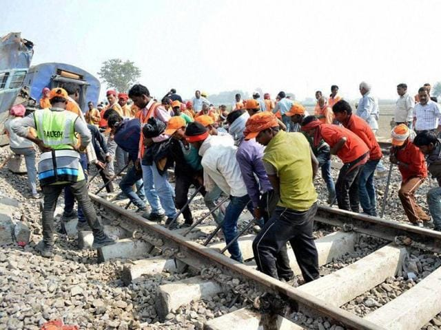 Rescuers and relief works in progress at the site of accident where Patna-Indore Express train derailed near Pukhrayan village in Kanpur Dehat district on Monday.