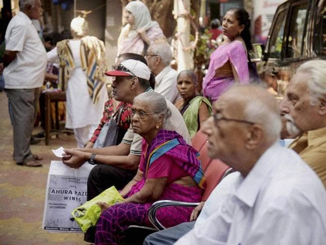 Senior citizens in queues to exchange their old Rs 500 and 1000 notes outside Bank at Mahim in Mumbai on Saturday.