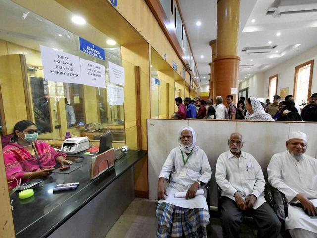 Senior citizens in a queue at a bank to exchange old notes at SBI bank in Hyderabad on Saturday.